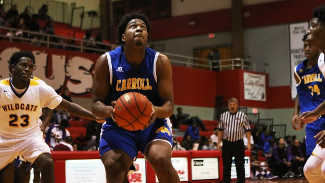 Larry Owens scored 18 points and took a charge that swung the first matchup between Carroll and Wossman in the C-Dogs' favor in the first round of the Don Redden Memorial Classic at Ouachita.