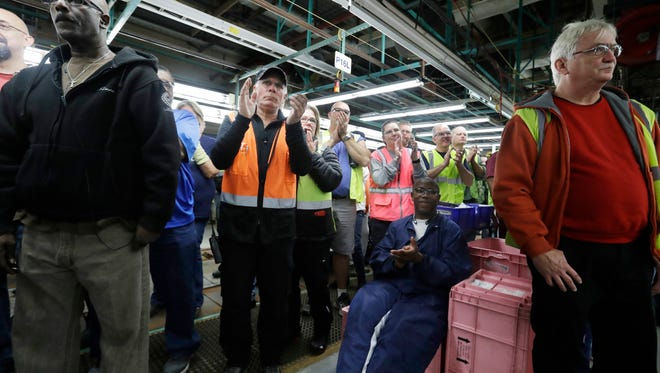 In this Tuesday, Jan. 3, 2017, file photo, Flat Rock Assembly employees clap as Ford President and CEO Mark Fields addresses the auto plant in Flat Rock, Mich. The threat from President Donald Trump to tax Mexican-made cars sold in the U.S. would throw the industry into disarray, analysts say. In early January, Ford made the surprise announcement that it would halt construction of a $1.6 billion plant in Mexico slated to build the compact Focus. It also announced plans to invest $700 million of that savings into a Michigan plant where it will make new electric and autonomous cars.