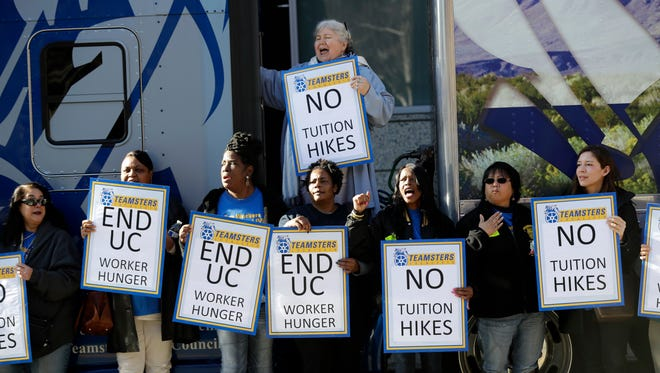 University of California employees, who are also members of the Teamsters Local 210, shout in protest against cuts in their benefits and tuition hikes outside of a University of California Board of Regents meeting in San Francisco.