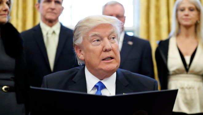President Trump talks in the Oval Office.