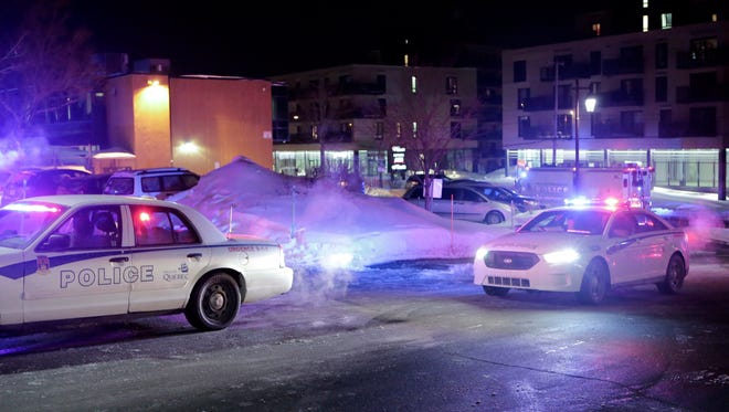 Police arrive at the scene of a deadly shooting at a mosque in Quebec City, Canada.