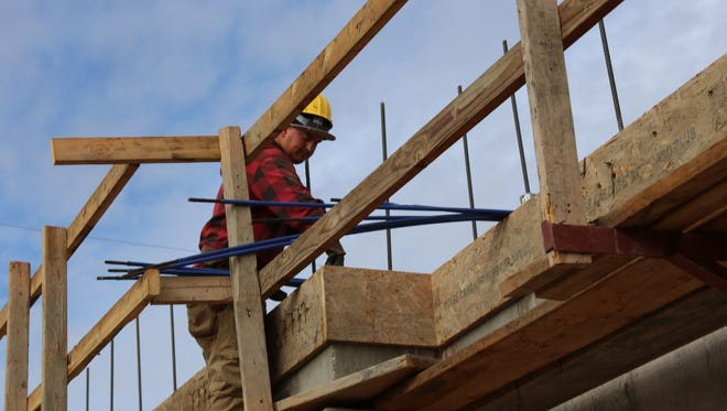 A crew members works on a new housing construction project on Tabernacle Street in downtown St. George Dec. 9, 2016. Rising housings costs contributed to a higher coast of living in southern Utah in 2016.