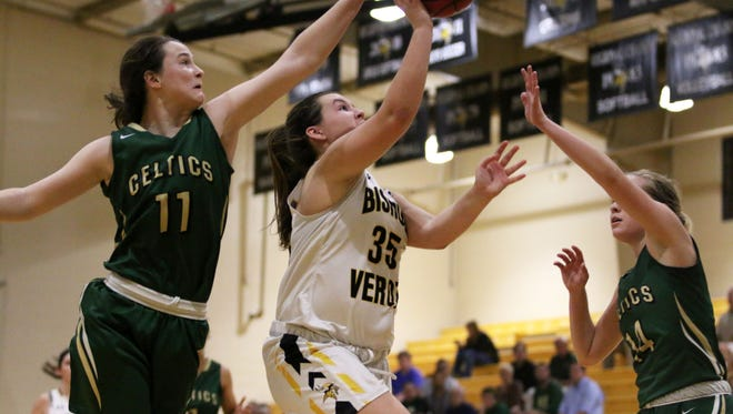St. John Neumann's Kelley Farrell, left, attempts to block Maggie Nolan (35) as she reaches for the layup during the Girls 5A-10 District Championship at Bishop Verot on Thursday, Feb. 2, 2017. The Vikings defeated St. John Neumann 42-36.