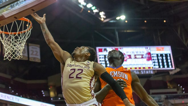 Junior guard Xavier Rathan-Mayes (22) slides past a Clemson defender for a bucket during Florida State's 109-61 victory on Sunday afternoon at the Tucker Center.