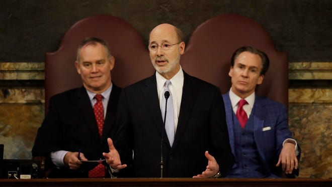 Gov. Tom Wolf delivers his budget address for the 2017-18 fiscal year to a joint session of the Pennsylvania House and Senate in Harrisburg Tuesday. Speaker of the House of Representatives, Rep. Mike Turzai, R-Allegheny, is at left, and Lt. Gov. Michael Stack, is at right.