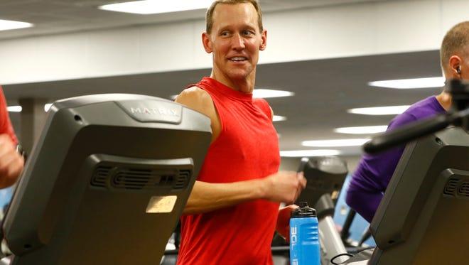 Chad Esker, of Mosinee, runs on a treadmill during his triathlon training Thursday, February 2, 2017, at the Aspirus YMCA in Weston.