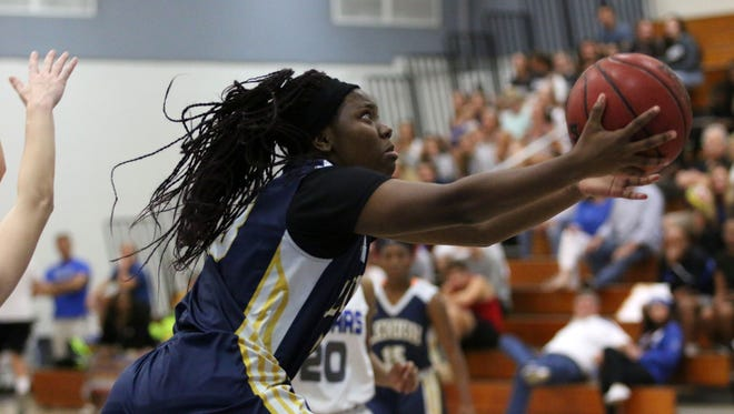 Lehigh guard Jermecia Down goes for the layup during the 7A regional quarterfinal between Barron Collier and Lehigh in Naples on Feb. 9, 2017.