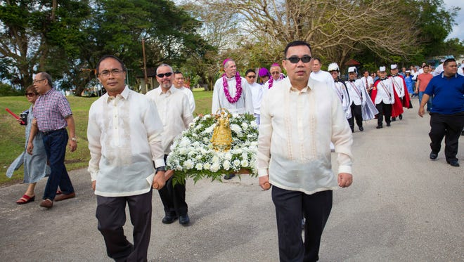 Many of the residents who attended the Special Mass said in Ilonggo on Feb. 5 at  Assumption of Our Lady Church in Piti, participated in the procession in an area just outside of the church with a replica of the statue of the Virgin Mary from the Jaro cathedral.
