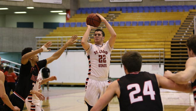 St. Cloud State's Scottie Stone shoots over the Minot State defense Saturday night.