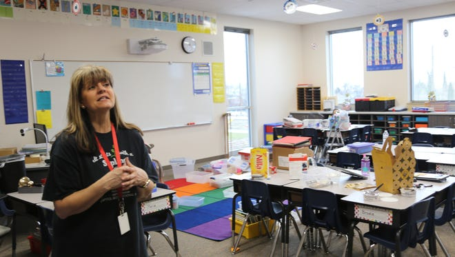 "Teacher Sydnee Jolley reminisces about East Elementary on Saturday, Feb. 11, 2017 as she and family members move her classroom materials in to the new Legacy school site. Legacy Elementary will welcome its formerly East Elementary students for a mid-year ""first day"" of classes Monday morning."