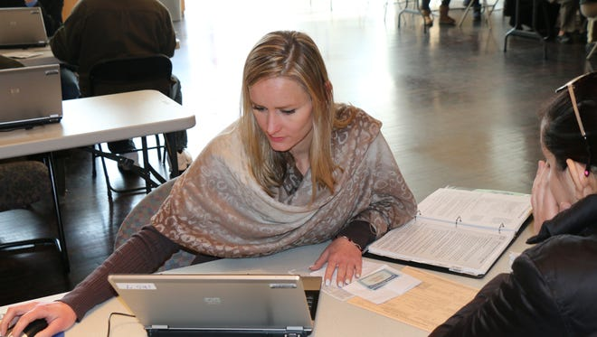 Agata Papis doing voluntary tax preparation work last year for the United Way of Passaic County's free program.