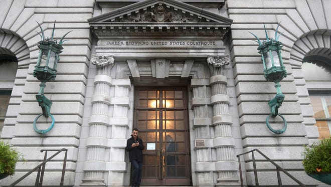 A man stands outside the main door outside the 9th U.S. Circuit Court of Appeals building Thursday, Feb. 9, 2017, in San Francisco. A federal appeals court refused Thursday to reinstate President Donald Trump's ban on travelers from seven predominantly Muslim nations, dealing another legal setback to the new administration's immigration policy. (AP Photo/Marcio Jose Sanchez)