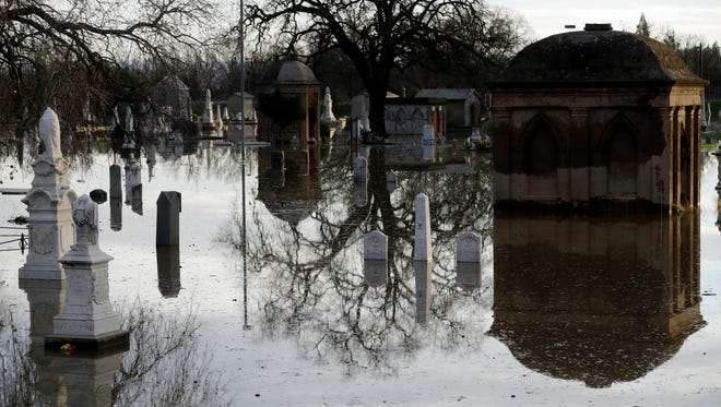 Graves are submerged in floodwaters Feb. 15, 2017, at a Marysville, Calif., cemetery downstream from Oroville Dam. Lake Oroville continues to drain as state water officials scramble to reduce the lake level ahead of forecast storms.