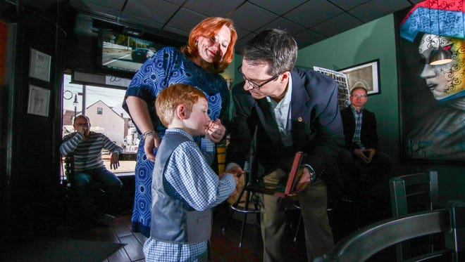 Michael J. Manley Jr., 5, and Amy Jo Fosdick is presented the Carnegie Award from Eric P. Zahren of the Carnegie Hero Fund Commission on Saturday, Feb. 18, 2017, at North Quarter Creole in Wilmington.