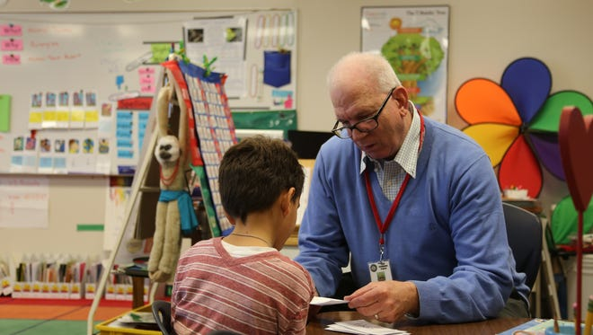 John Gordon, a volunteer with the Foster Grandparent program, reads with a 1st grade student at Heritage Elementary School in St. George on Wednesday, Feb. 15, 2017.