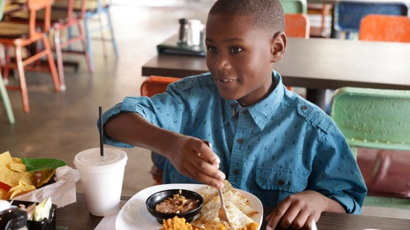 Nine-year-old food critic Kelon George at Agave in