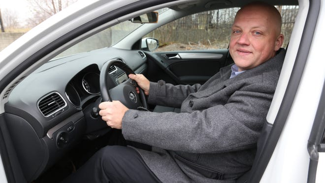 Oliver Schmidt, VW General Manager for the Engineering and Environmental Office, poses for a portrait in a 2015 Volkswagen e-Golf in Auburn Hills in November 2013.