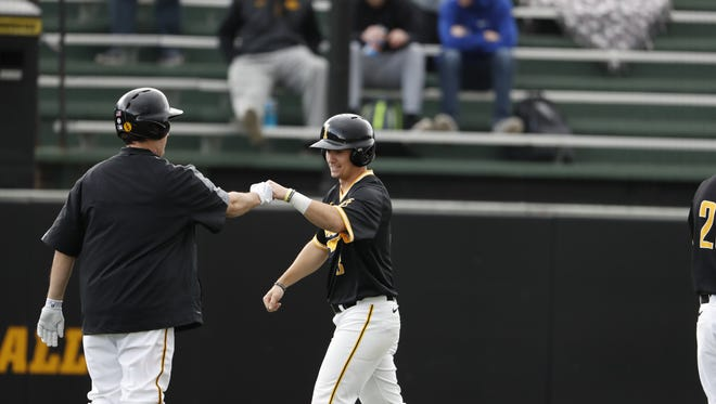 Iowa's Matt Hoeg celebrates after scoring in a 12-8 win over Northern Illinois at Duane Banks Field in Iowa City on Tuesday, March 7, 2017.