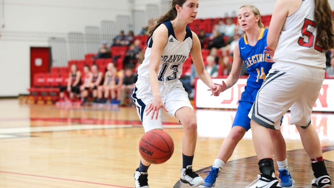 Granville's Felicia Atkinson looks to move around a screen by Johnstown's Sammy Edwards during the Licking-Muskingum all-star game at Denison University.