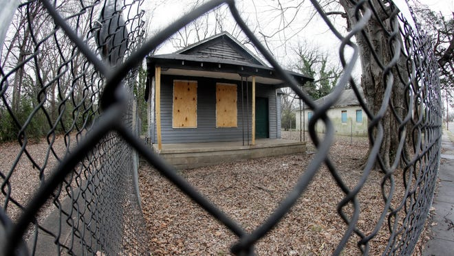 The abandoned childhood home of singer Aretha Franklin sits behind a security fence in Memphis on Jan. 16, 2017. Recently, the Franklin birthplace and the surrounding neighborhoods have moved to the forefront of a large cleanup effort, as the city refuses to accept decay as a fact of life in the urban landscape.