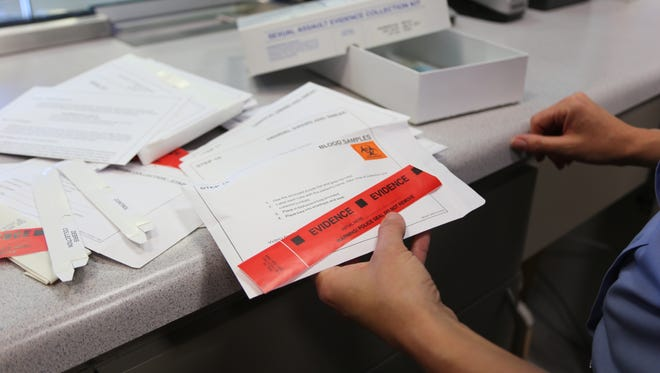A St. George Police Department officer unboxes a new rape kit.