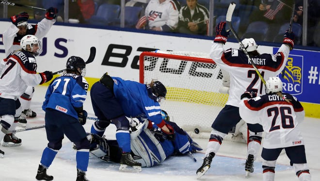United States forward Hilary Knight (21) celebrates her goal on Finland goalie Noora Raty during the second period of a IIHF Women's World Championship hockey tournament game, Monday, April 3, 2017, in Plymouth, Mich.