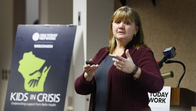 Debi Traeder, who is a QPR master trainer, speaks to nearly 25 people Tuesday night about the warning signs of suicide and how to help someone who may need help.