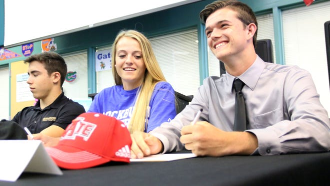 Brandon Rokela smiles after signing his NLI to play rugby at Arkansas State University morning's spring signing ceremony at Gulf Coast High School on Wednesday, April 12, 2017. Students, friends, and family gathered in a crowded media center Wednesday morning to watch a record 14 student-athletes sign with collegiate programs.