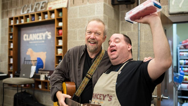 "Songwriter Don Schlitz hangs out with Rocky on April 6, 2017, at Clancey's Crossroads Cafe, part of the Room in the Inn. Rocky, who's at nearly all of Schlitz's Thursday morning performances, says, ""My biggest moment came when he called me his friend."""