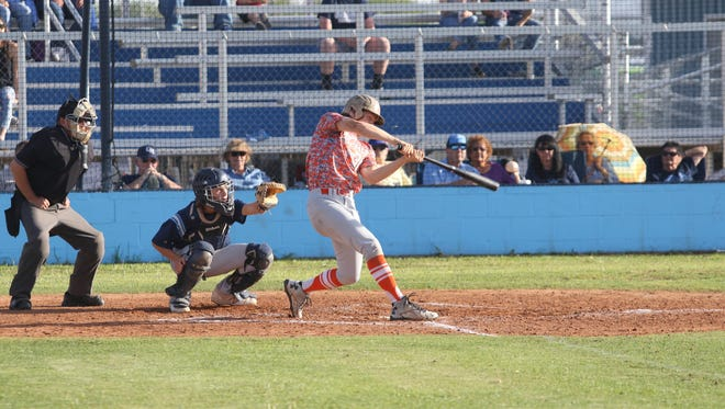 Artesia's Tanner Harris makes contact at the plate Friday at Goddard.