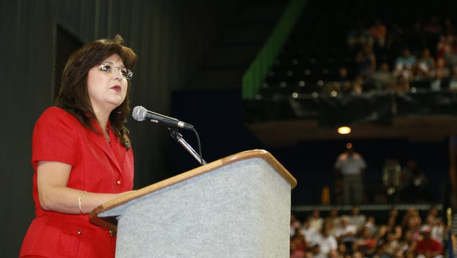 Principal of Ray High School Cecilia Reynolds-Perez greets everyone at the Ray High School graduation ceremony at the American Bank Center on June 7, 2014.