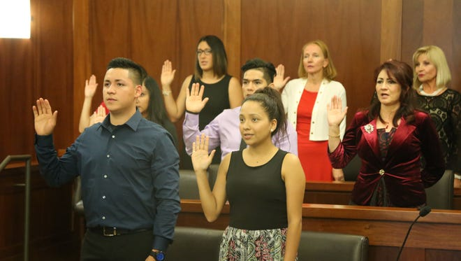 Southern Utah residents take the U.S. oath of citizenship Monday during the first-ever naturalization ceremony at the federal courthouse in St. George.
