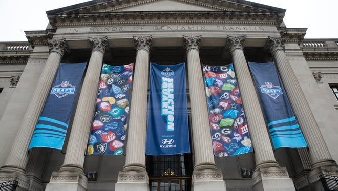 Banners hang from the Franklin Institute ahead of the 2017 NFL football draft, in Philadelphia, Wednesday, April 26, 2017.