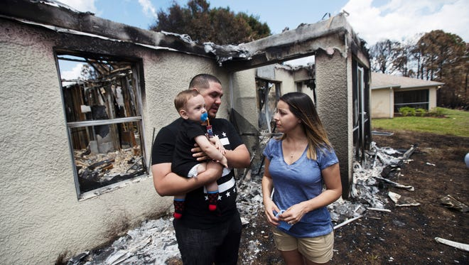 Lehigh Acres residents, Jorge and Valerie Rivera talk about the experience of losing their home to Friday's brush fire. They are seen with their seven month old son, Austin.