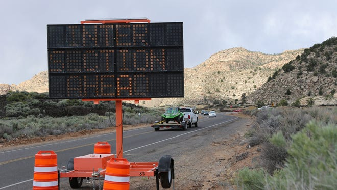 An electronic sign alerts drivers ahead of the intersection where Diamond Valley Drive runs into state Route 18 on Friday, April 28, 2017.