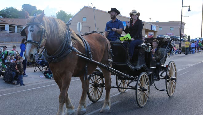 Parade-goers watch as a horse-drawn carriage travels Telegraph Street on Saturday during the annual Cotton Days heritage festivities in Washington City.