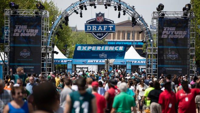 Fans gather for the 2017 NFL football draft, Saturday, April 29, 2017, in Philadelphia. (AP Photo/Matt Rourke)