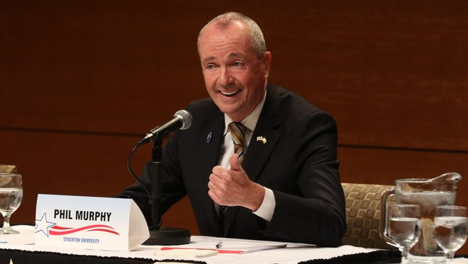 Democratic candidate Phil Murphy answering a question.