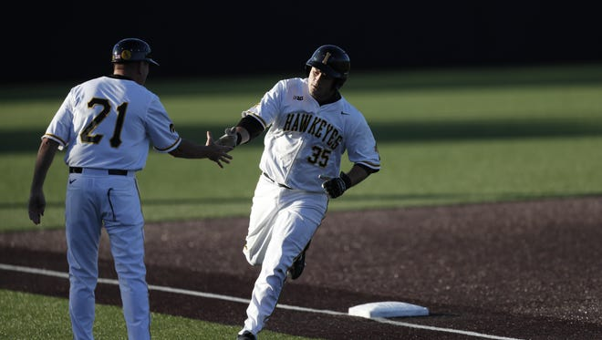 Jake Adams rounds third base after homering in Iowa's 9-5 win over Ohio State on May 12 at Duane Banks Field.