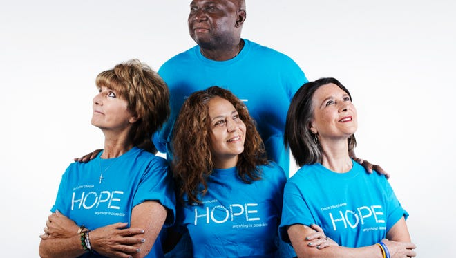 From left, Janice Karkis, Tony Martin, top, Noemi McDonald and Melissa Crouse. All four have stage 4 lung cancer. This month is Lung Cancer Awareness Month. This group attended the Hope Conference, a LUNGevity Foundation conference