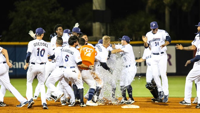 The Blue Wahoos celebrate Brian O'Grady's walk-off, two-run double that produced a 3-2 victory Thursday against the Mobile BayBears