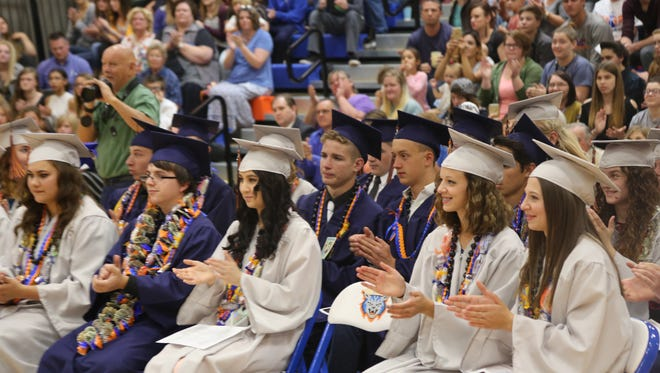 Students at Water Canyon High School cheer during a graduation ceremony Monday, May 22, 2017.