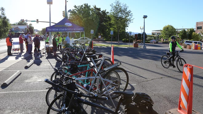 """Cyclists stop in for snacks and conversation during a """"pit stop"""" event hosted by the Southern Utah Bicycle Alliance, City of St. George and Southwest Utah Public Health Department on Friday, May 19, 2017."""