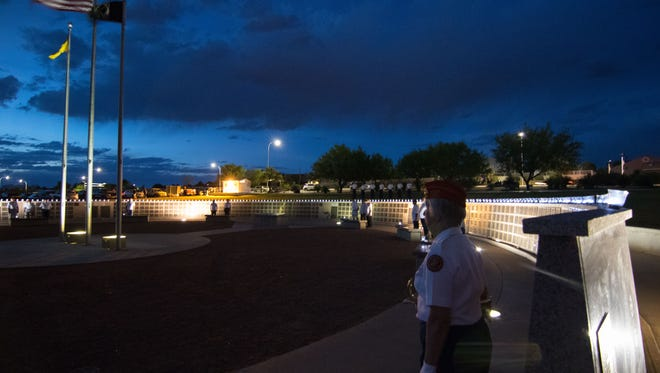 On Memorial Day, May 29, 2017, members of the Military Order of the Purple Heart are illuminated atop the Veterans Memorial Park wall commemorating the 203 Doña Ana County residents who have been killed in action from World War I through Operation Enduring Freedom.