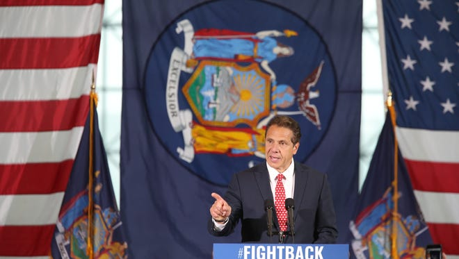 New York Gov. Andrew Cuomo speaks at a rally, Tuesday, June 6, 2017 in New York. Cuomo and House Minority Leader Nancy Pelosi, D-Calif., are hoping to increase the number of congressional seats held by the Democratic Party. (AP Photo/Mary Altaffer) ORG XMIT: NYMA302