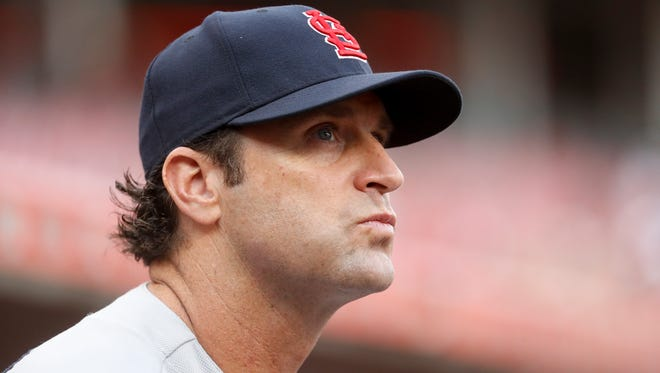 St. Louis Cardinals manager Mike Matheny works in the dugout in the second inning of a baseball game against the Cincinnati Reds, Monday, June 5, 2017, in Cincinnati. The Reds won 4-2. (AP Photo/John Minchillo)