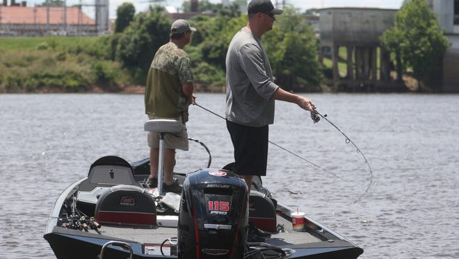 Jack White, background, fishes on the Ouachita River with Jack White Jr., foreground, as they compete in the Big Bass Tournament benefiting the Ronald McDonald House of Northeast Louisiana in West Monroe, La., Saturday, June 10, 2017.