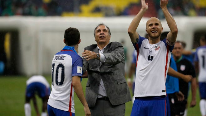 Bruce Arena, center, has brought a new attitude to the U.S. team and players such as Christian Pulisic, left, and Michael Bradley.