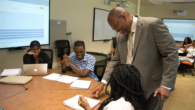 Desmond Stephens, an associate professor in the College of Science and Technology, works here with STEM students,
