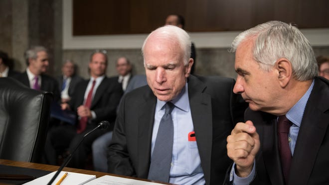"Senate Armed Services Committee Chairman John McCain, R-Ariz., (left) confers with Sen. Jack Reed, D-R.I., the ranking member, at the start of a hearing at the Capitol in Washington, Tuesday, June 20, 2017.  McCain said Tuesday that North Korea ""murdered"" Otto Warmbier, the 22-year-old American college student who died just days after North Korea released him from detention in a coma. He had arrived in Ohio on June 13 after being held for more than 17 months."